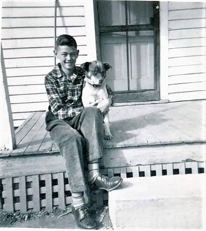 Vic and his dog, Pal, on the back porch of their Chester home. As a child Vic used his middle name, Lowell, to keep people from confusing him with his father.