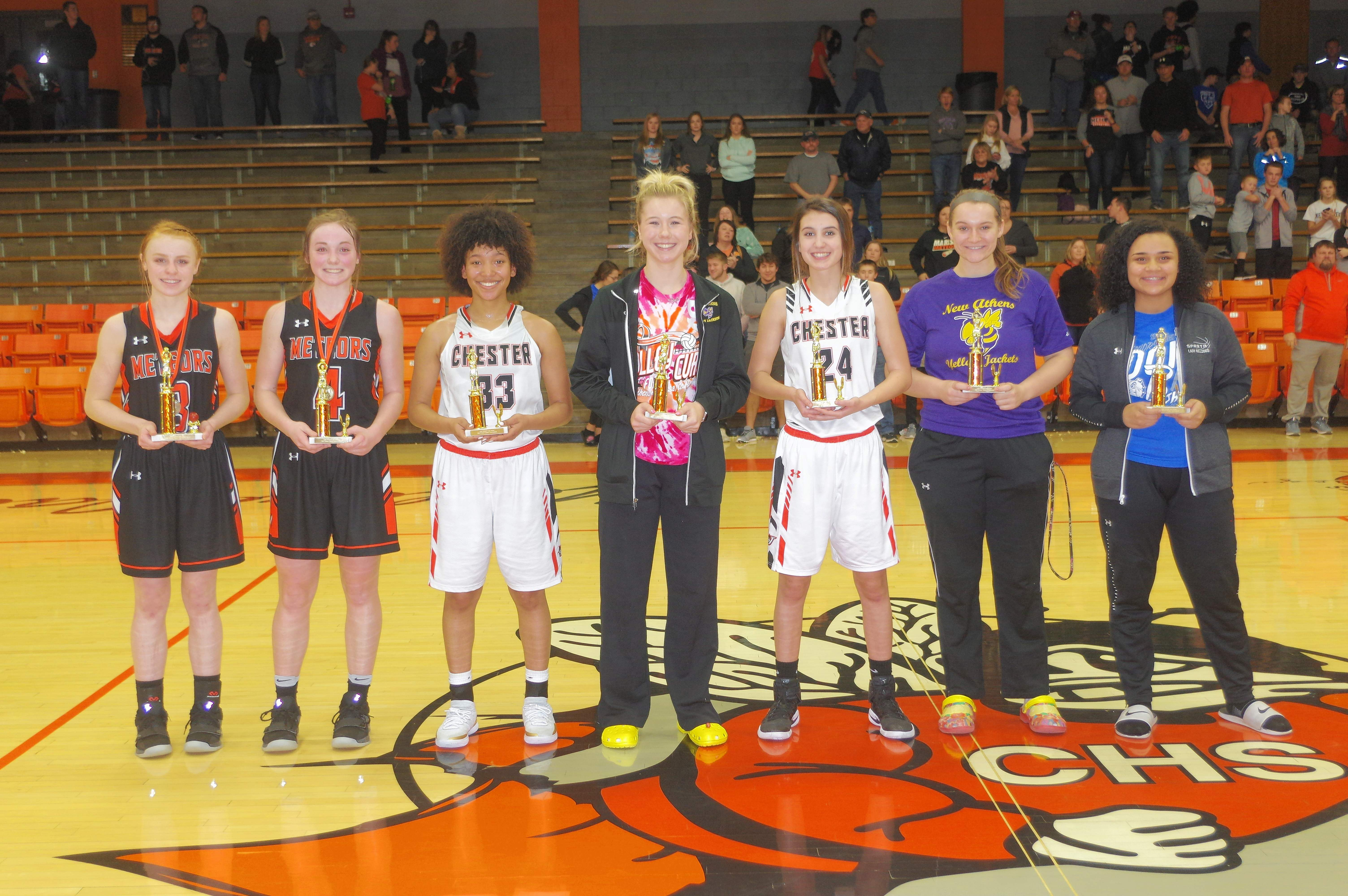 The 2019 Lady Jacket Mid-Winter Classic Basketball Tournament All-Tournament Team, from left: Most Valuable Player Emily Smith, sophomore from Marissa-Coulterville; Bree Portz, freshman from Marissa-Coulterville; Destiny Williams, junior Lady Jacket; Danika White, junior from New Athens; Reese Chandler, sophomore Lady Jacket; Julia Drake, junior from New Athens; and Amyia Henry, senior from Sparta.Not present for the ceremony: Allie Whittington, senior from Elverado; Jenna Cottom, sophomore from Trico; and Tinleigh Jakimauskas, sophomore from New Athens.