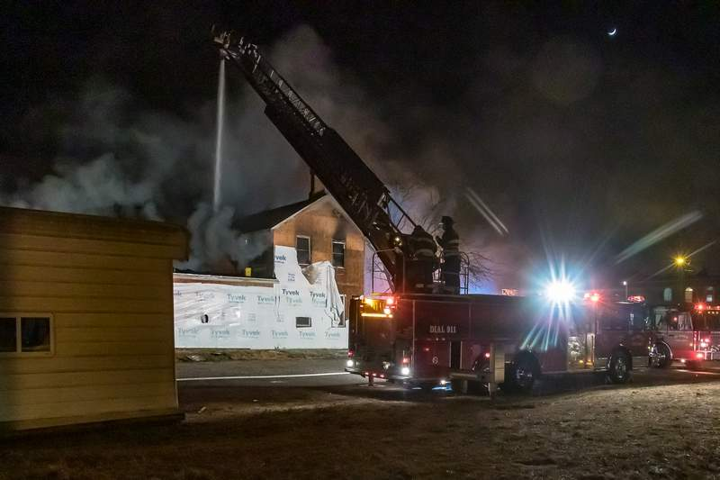 Du Quoin fire crews work from a ladder truck to extinguish a fire that destroyed a historic Du Quoin home on North Mulberry Street.