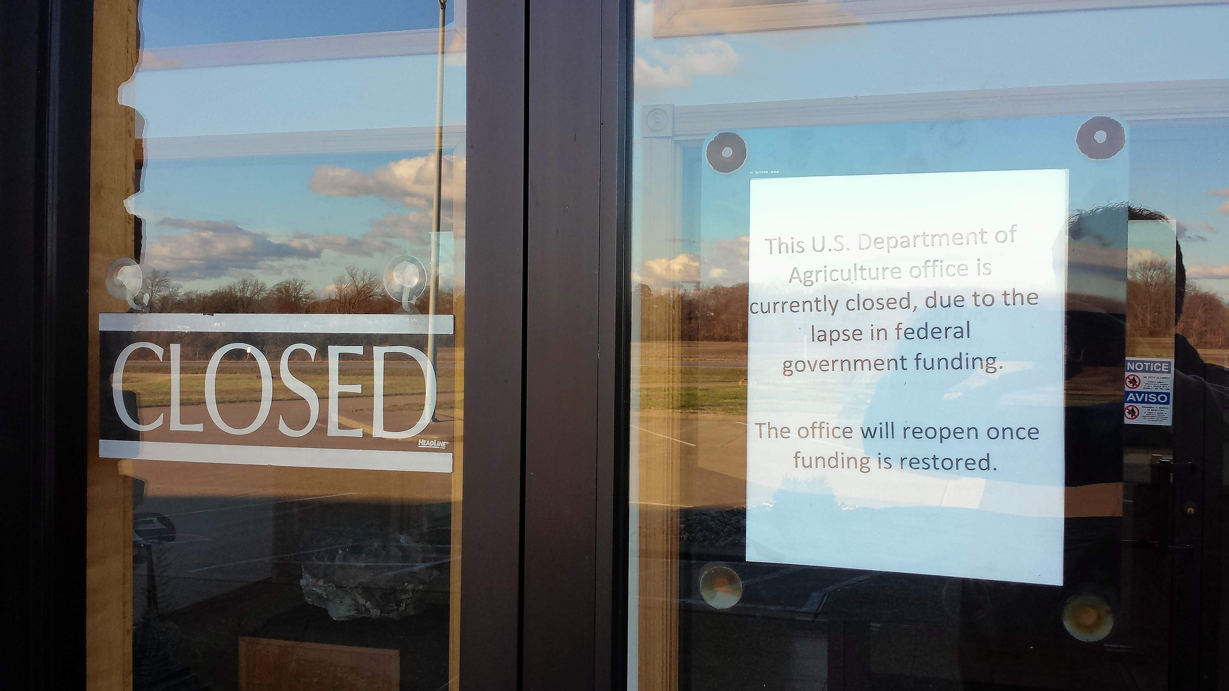 A sign on the door of the Shawnee National Forest headquarters in Harrisburg tells visitors of the government shutdown and its effect on forest areas.