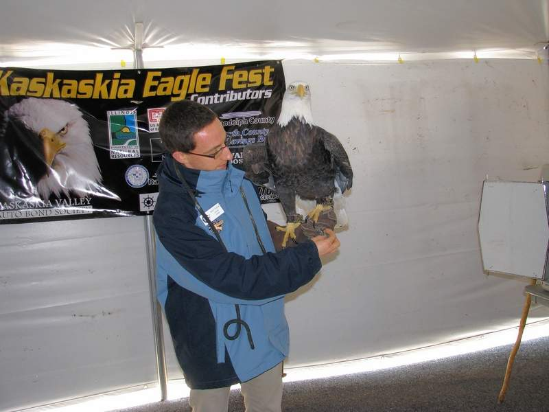 An unidentified birder from the World Bird Sanctuary holds a program at Eagle Fest.