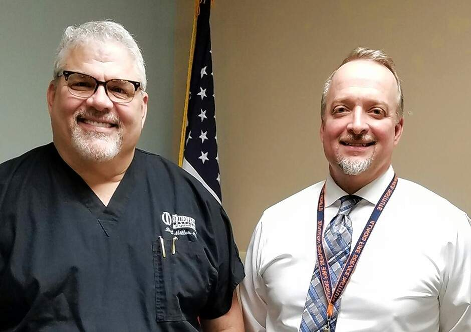 The Chester Rotary Club met with orthopedic surgeon Dr. Bret Miller, left, and Brett Bollmann, CEO of Memorial Hospital.