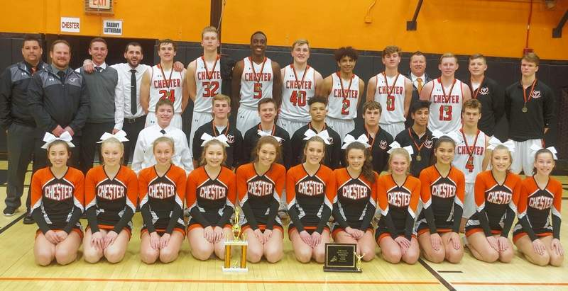 The Chester High School Boys Basketball Team, coaches, manager and cheerleaders following the presentation of the CIT Championship trophy and the CIT Cheer Competition Championship trophy. Chester won both first place trophies this year.
