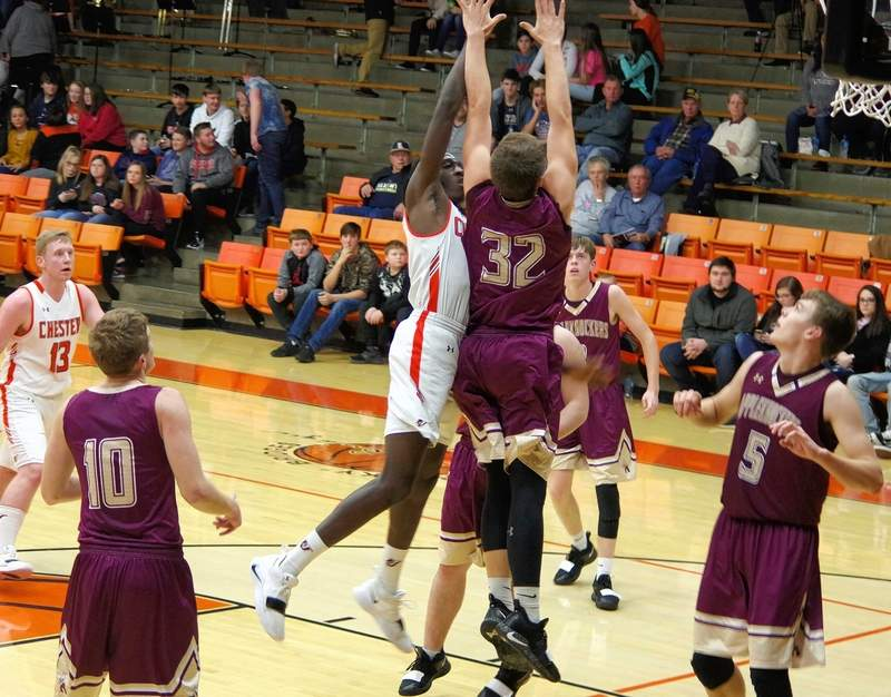 Chester's big man, Keith Kiner III, takes a short jumper over Cobden's Joe Brumleve (32). Kiner led Chester scoring in the championship game with 15 and had 55 for the tournament.