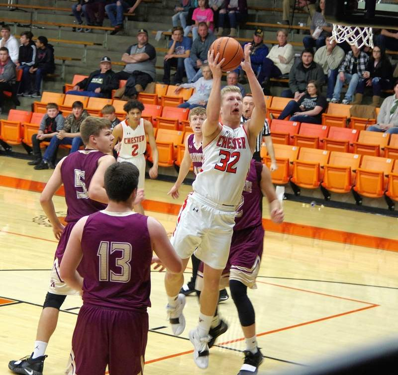 CHS junior Ian Reith (32) drives to the basket and is met by Appleknockers Joe Blumleve (32), Dylan Lewey (10), and Noah Franklin (5).