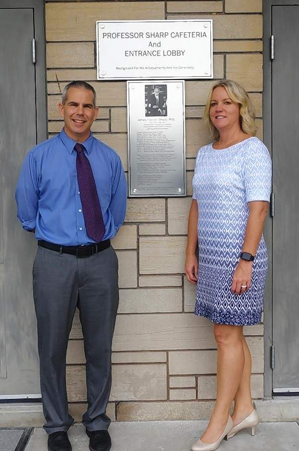 Superintendent Brian Pasero and Chester High School Principal Melissa Meyer, at the site of one of the new plaques.