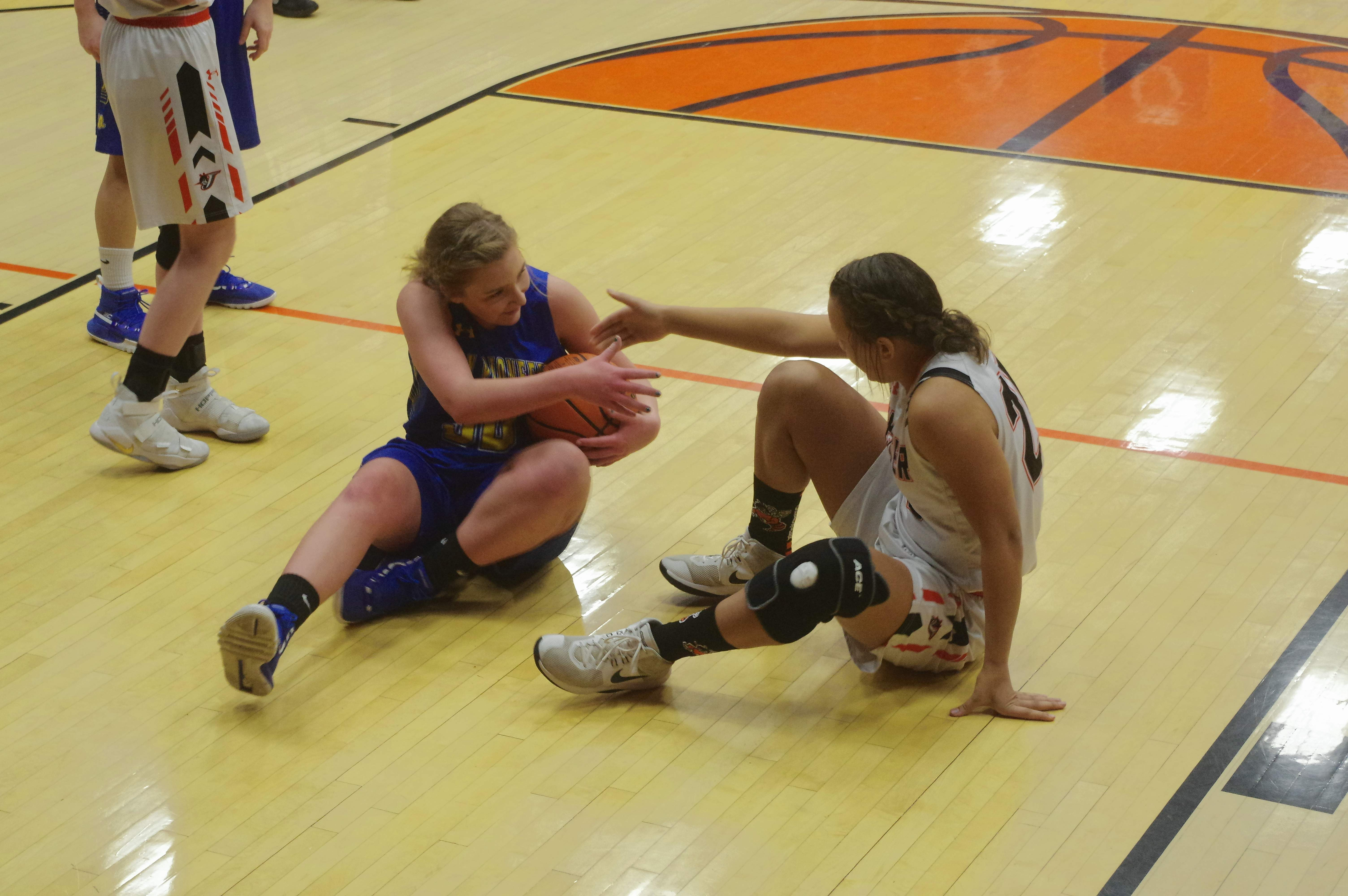 Chester's Kailyn Absher (25) (right) and Trico's Rayahna Foutch offer each other assistance after they both dove for a loose ball on Jan. 31.