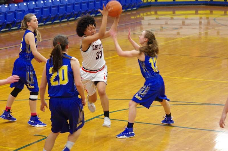 Lady Jacket Destiny Williams drives hard to the basket in traffic in the Trico game on Monday. She hit the shot.