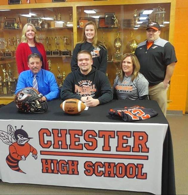 Chester High School senior, Chase Colvis, front and center, signs a letter of intent to play football next fall at McKendree University. With him in front are Charles Colvis, his father and Tabatha Colvis, his mother. Standing are, from left, Missy Meyer, CHS Principal, Ashlyn Colvis, Chase's sister, and Billy Belton, CHS Head Football Coach.