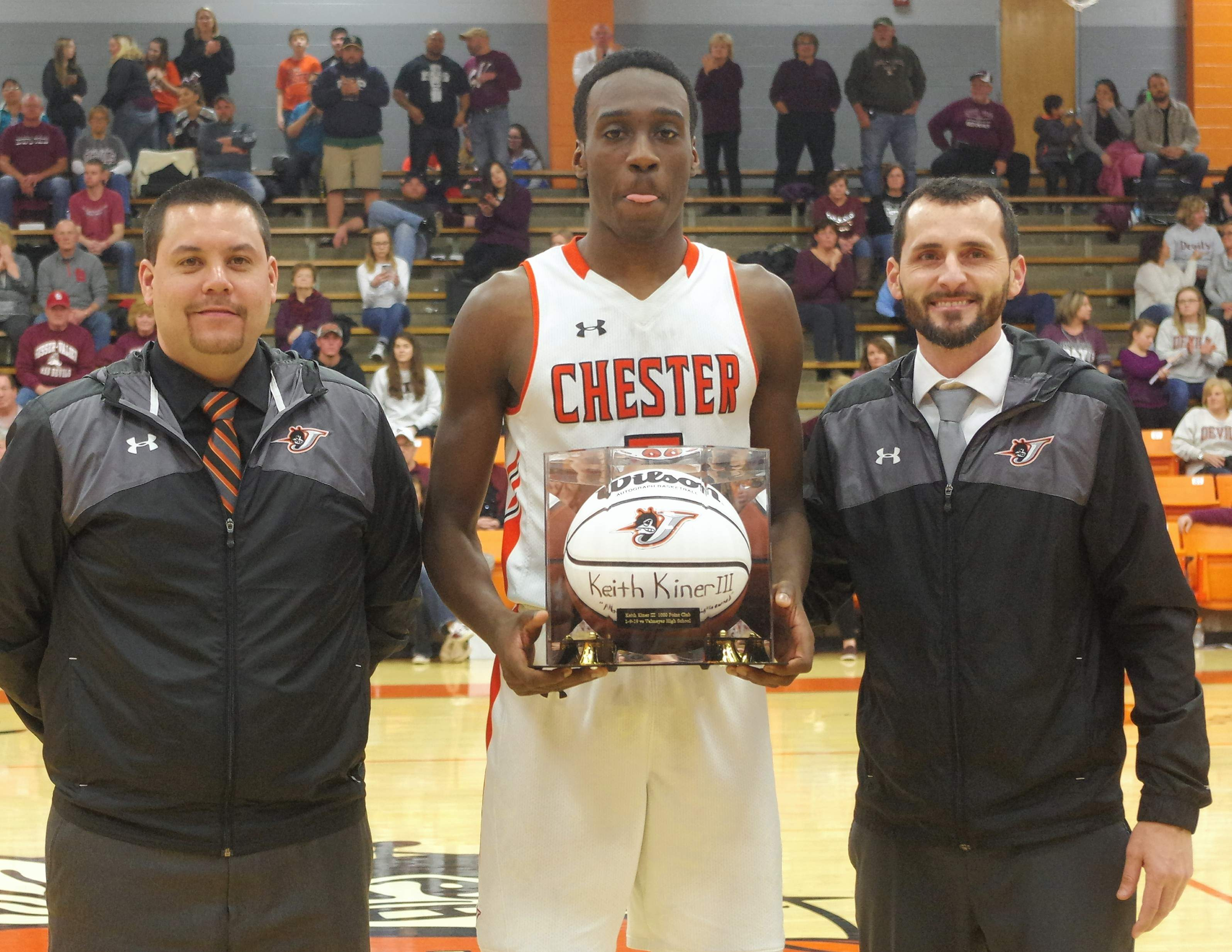 Keith Kiner III, center, with Assistant CHSBasketball Coach Chris Toledo, left, and Head Coach Brad Norman, following a special presentation prior to the start of the CHS vs. Sesser game on Feb. 16.Kiner was honored for scoring his 1,000th careerpoint this season.