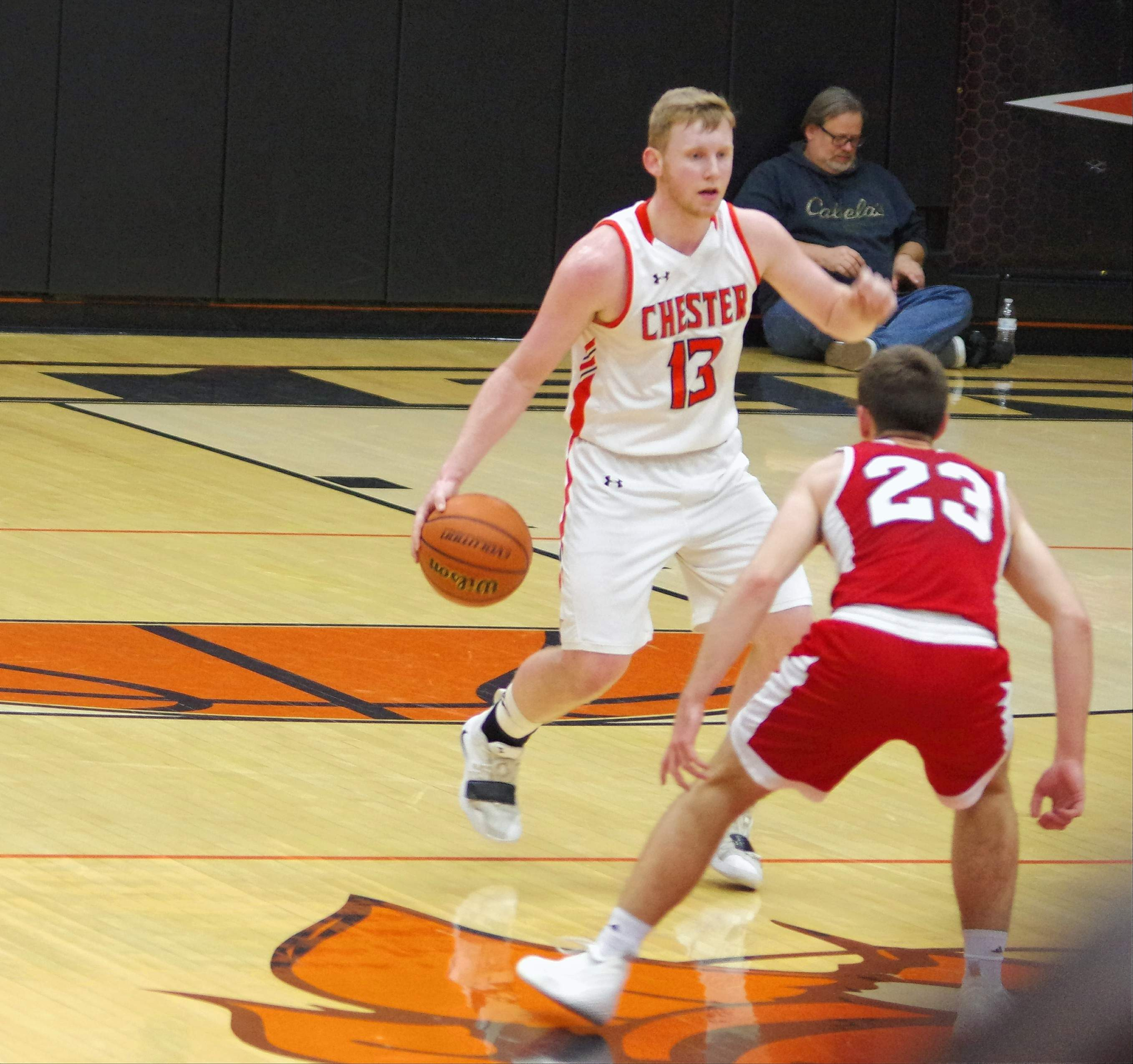 Jakob Cushman, brings the ball across the half-court line and is met by Redbird Kyle Hummers.