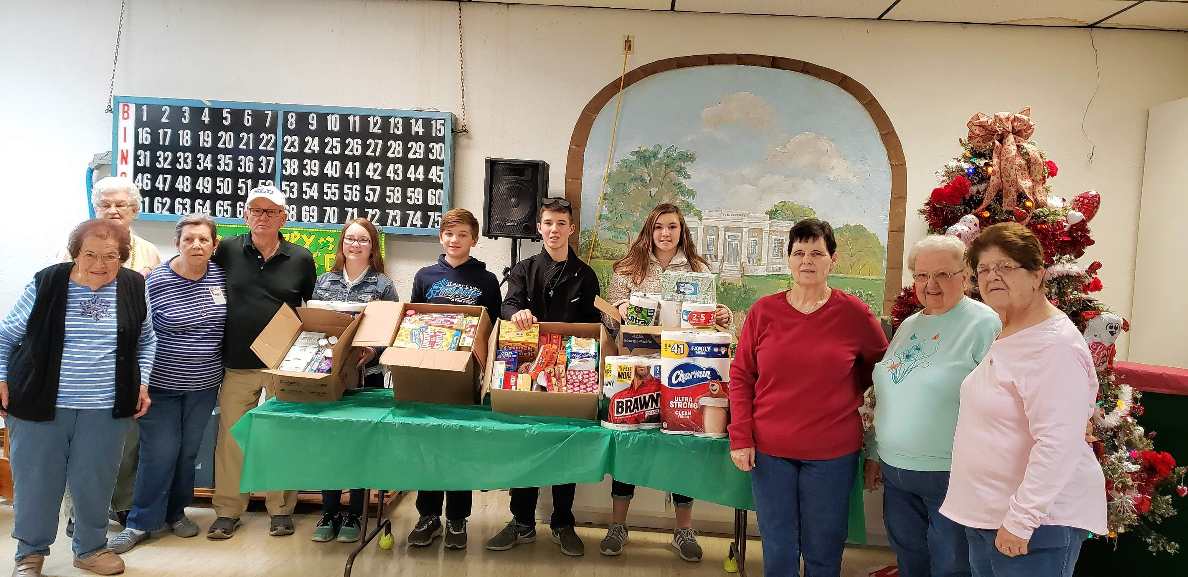 From left: Dolores Waltemate; Marlene Eckert; Donna Phelps; Bill Heffernan (senior center bingo caller); Elseah Congiardo, 7th grade; Kolton Jany, 6th grade; Koby Jany, 8th grade; Paige Vasquez, 8th grade; Carol Holley; Eileen Crowder and Judi Rice.