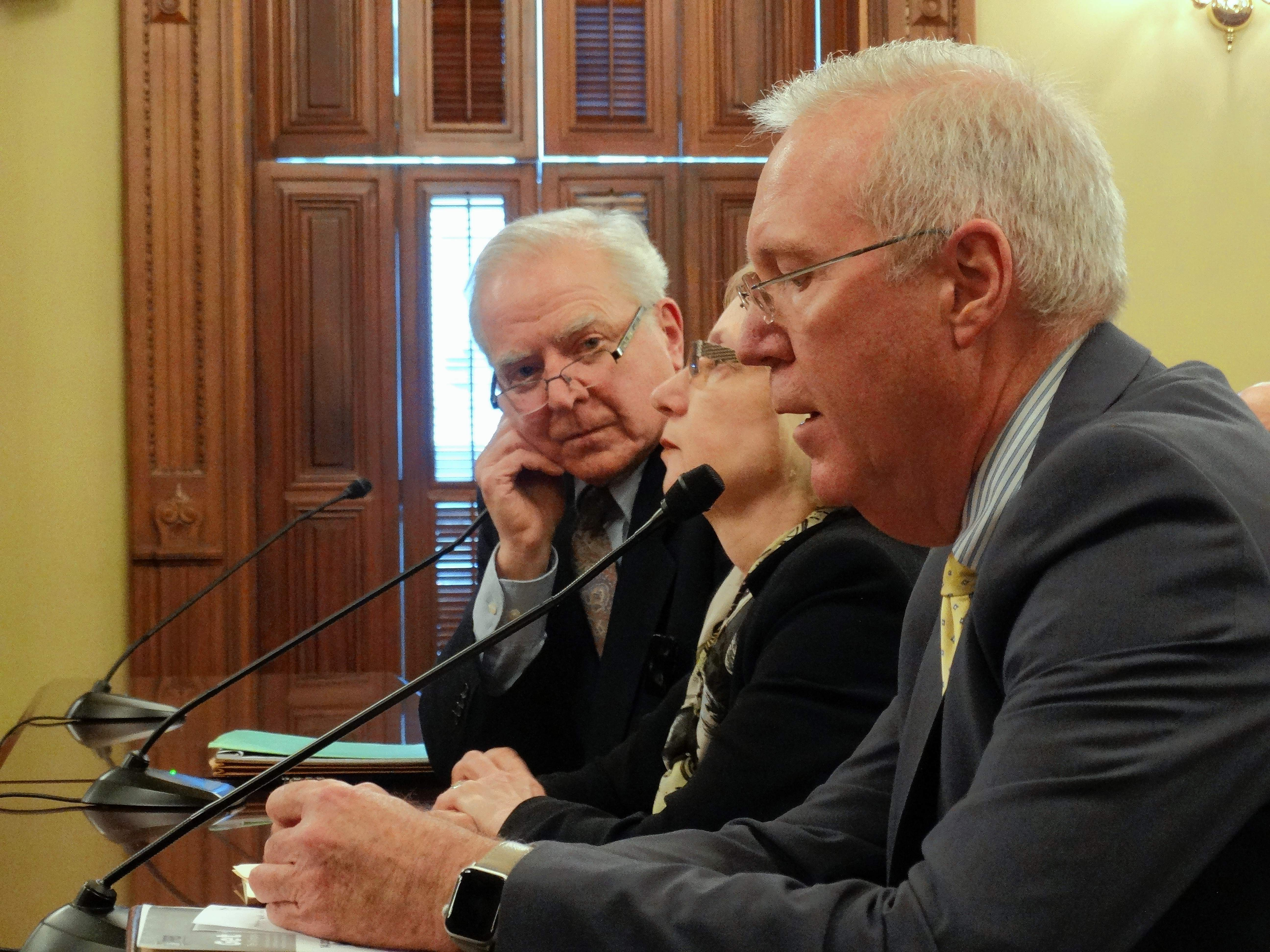 """Dan Reitz (front), a lobbyist for the Illinois Oil and Gas Association, speaks against a bill that would require more public disclosure of hydraulic fracturing, or """"fracking"""" operations in the state, while Rep. Robyn Gabel, an Evanston Democrat, and Bill Rau of Illinois People's Action testify in favor Tuesday at the Capitol in Springfield."""