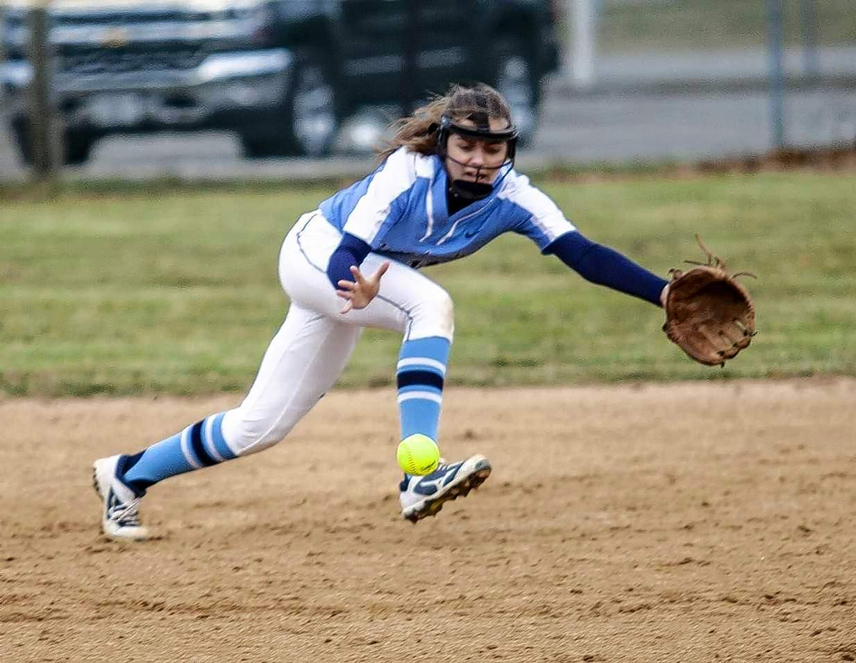 Lady Panthers shortstop Megan Engelhardt dives for a ground ball in game action Wednesday with Waltonville. She came up just short on this attempt.