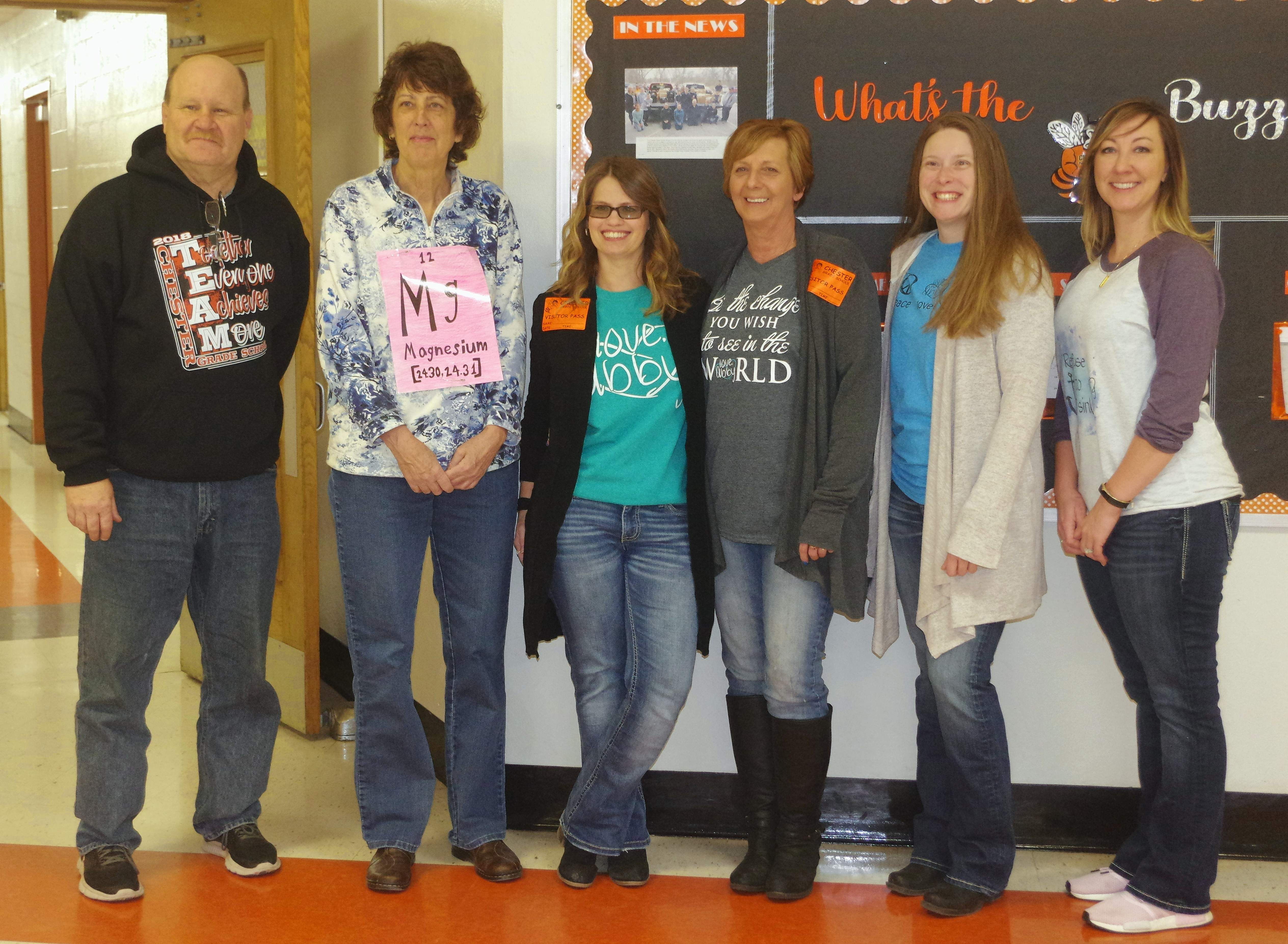 From left, Tim Lochhead, CGS principal; Joann Meyer; Terri Liefer, Abby's mother; and Kathy Baker, Dana Ernsting and Jessica Bland from the Love Abby staff.