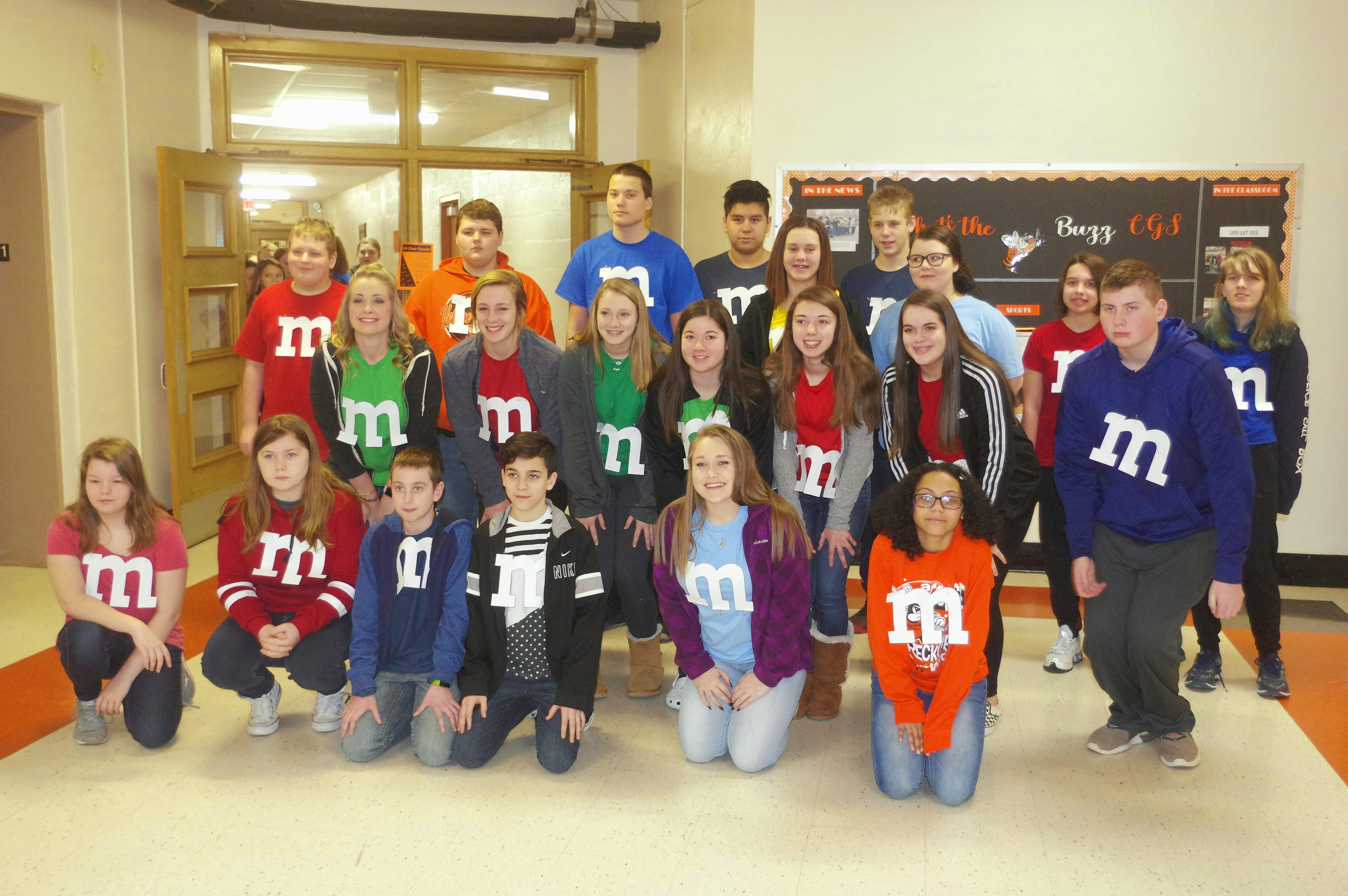 """Members of Jenny Krantz's eighth grade class at Chester Grade School dress like their favorite M&M candy colors, part of the effort that raised $1,100 for the March """"Give Back"""" project."""
