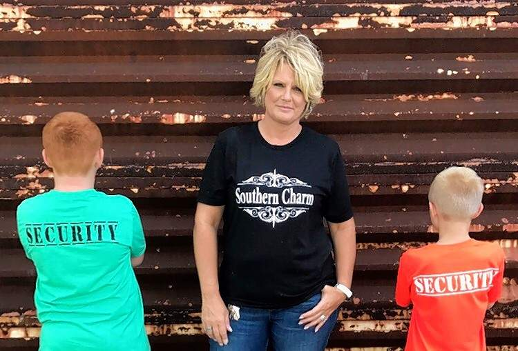 Laurie Cummins-Wheeler with her two-kid security team.