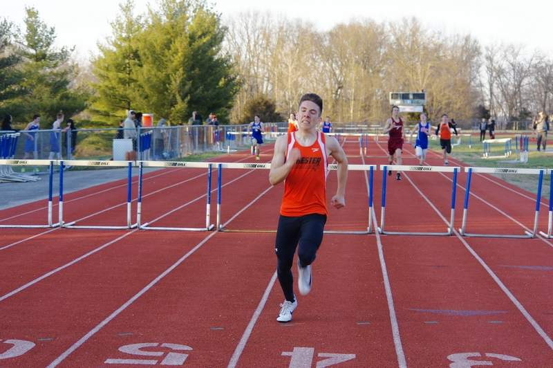 Sophomore Gage Garniss sprints to the finish line in the 110-meter hurdles on March 21.