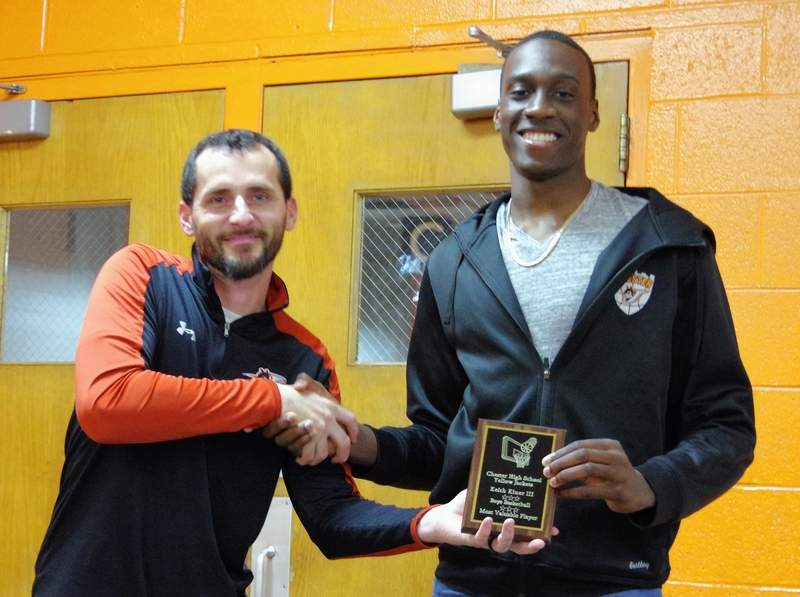 "Head Coach Brad Norman, left, presents Keith Kiner III with the ""Player of the Year"" plaque."
