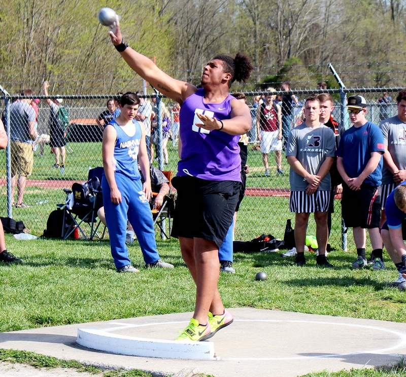 Zach Gibbs competes in the shot put for the Harrisburg High School track and field team at the recent Herrin Invitational.