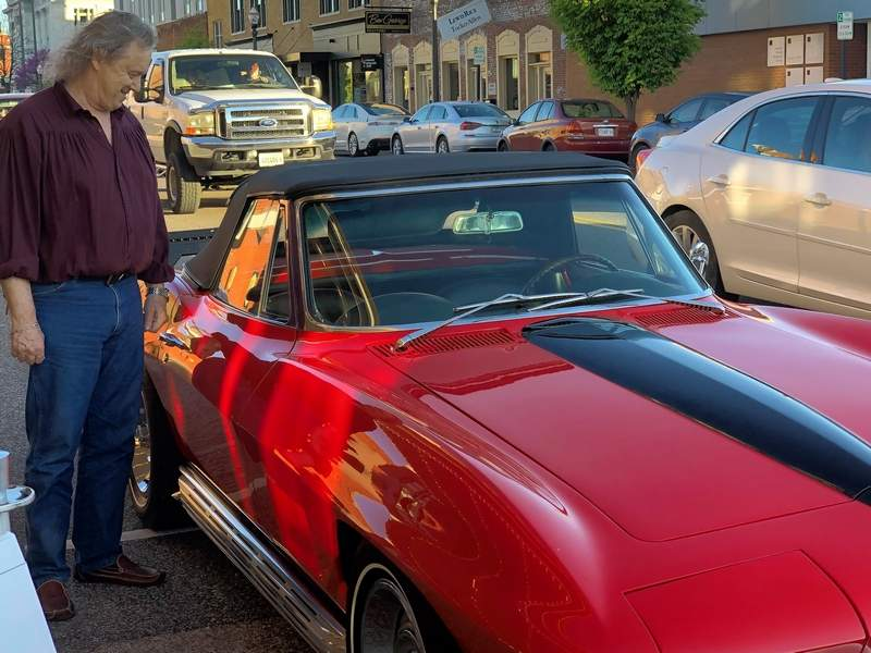 """Actor Les Lannom smiles as he looks at a Corvette Stingray similar to one he drove during the filming of the 1978 cult classic """"Stingray."""""""