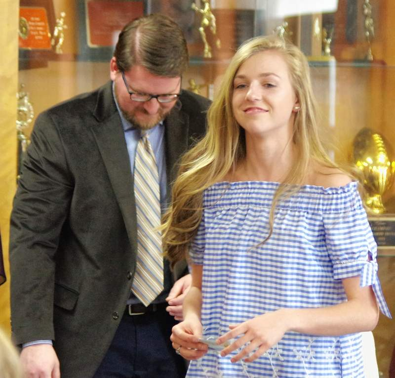 Chester High School sophomore, Josie Kattenbraker, receives her NHS pin after the induction ceremony.