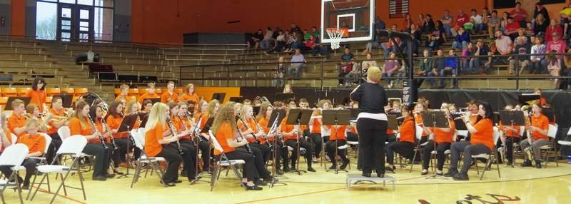 Sue Colonel directs the junior high band at the 2019 CGS Spring Concert.