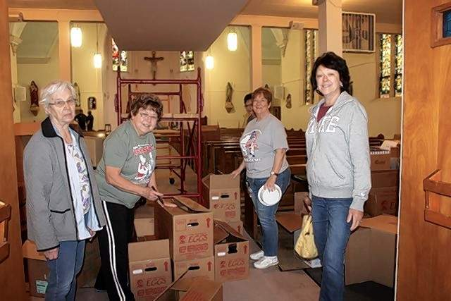 Ladies of the church pack up hymnals. From left, they are Rosemary Bert, Paula Platt, Kathy Hustedde, Bonnie Todd and partially hidden, Mary Ridgeway.