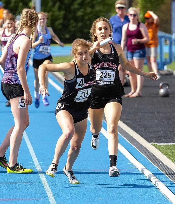 Olivia Phillips passes the baton to Gabby Alongi during the 4x400 meter relay.