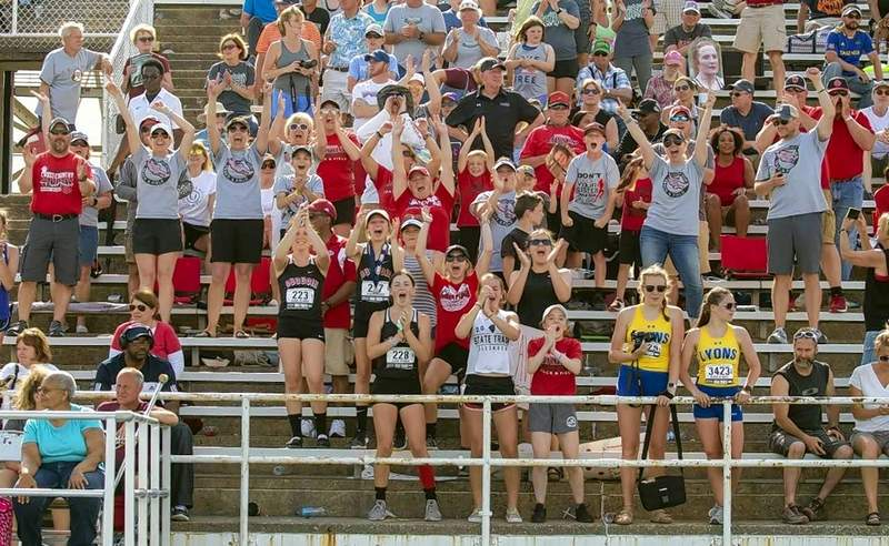 Du Quoin fans cheer on the team's victory in the 4x400 meter relay at the end of Saturday's events.