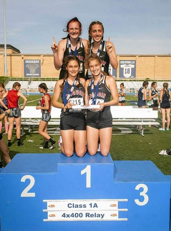 The Lady Indians' 4x400m relay team receives their gold medals; (back, L-R: Madison Davis, Olivia Phillips; front, L-R: Grace Alongi, Gabby Alongi)