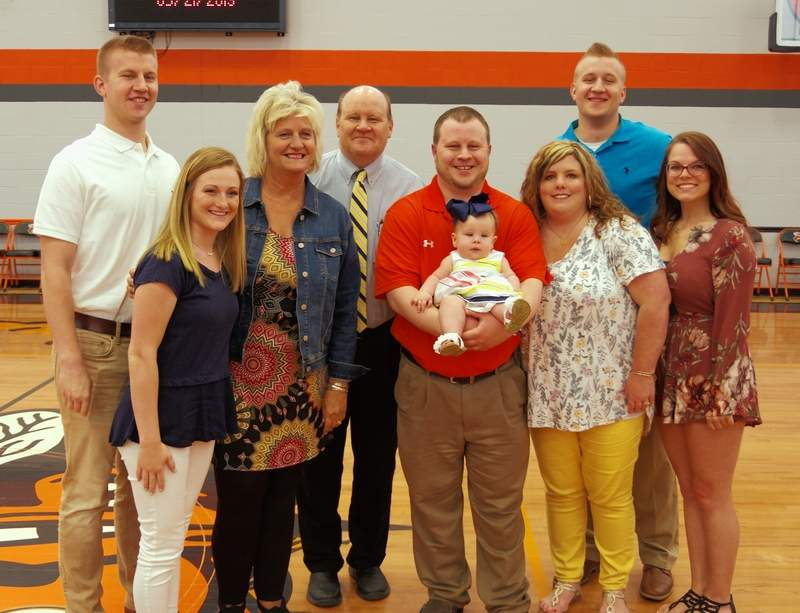 Tim Lochhead and his family following the recognition ceremony. From left are son Jacob Lochhead and his girlfriend Annika Ochs; Wendy Lochhead; Tim Lochhead; Luke Lochhead, holding his daughter Saylor; Ashley Lochhead; Zachary Lochhead and his girlfriend, Miranda Julian.