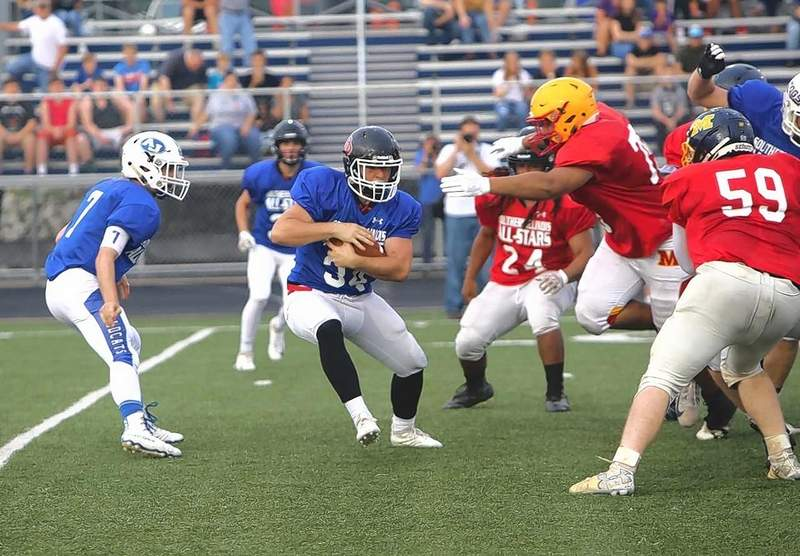 Du Quoin's Westly Milam looks for room to run in All-Star game action Friday.