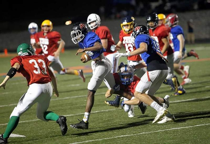 Du Quoin receiver Anthony Cole makes a nice offensive play for the Blue team.