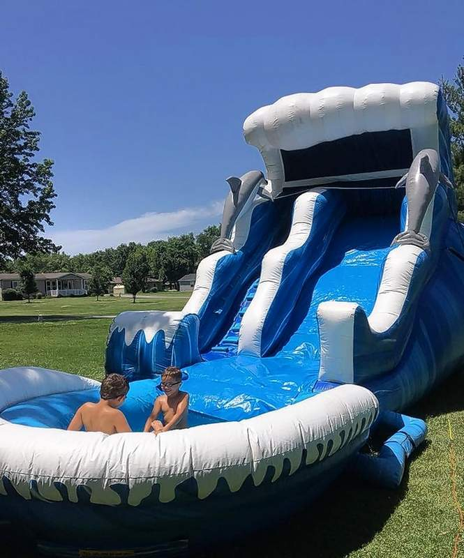 Two boys enjoy splashing in an inflatable waterslide, one of several rented by Southern Illinois Inflatables.