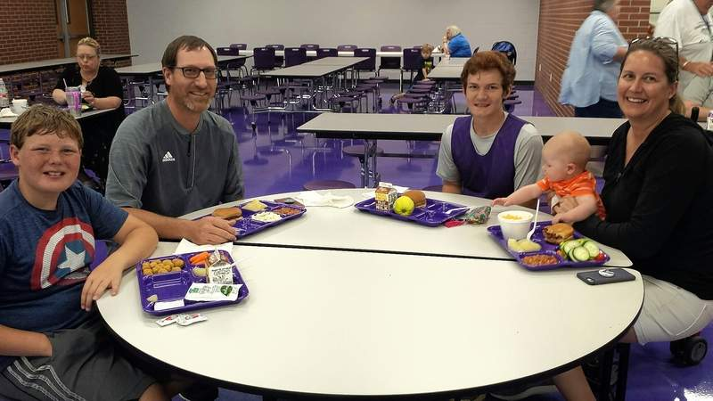 Members of the Miller family of Harrisburg enjoy the Harrisburg Unit 3 Summer Lunch Program Monday in the Harrisburg High School cafeteria. From left are Isaac, Jeff, Mark, Ethan and Dr. Andrea Miller.