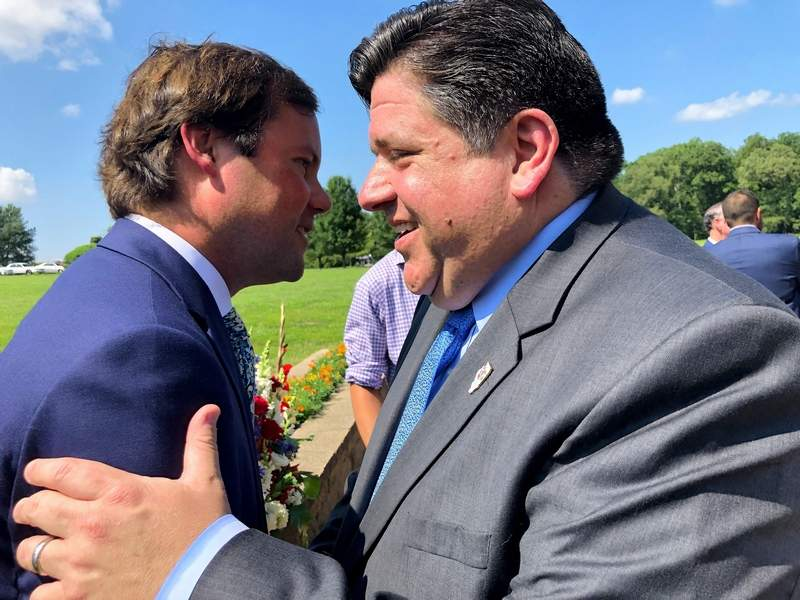 Williamson County States Attorney Brandon Zanotti shares a laugh with Gov. J.B. Pritzker Tuesday morning.
