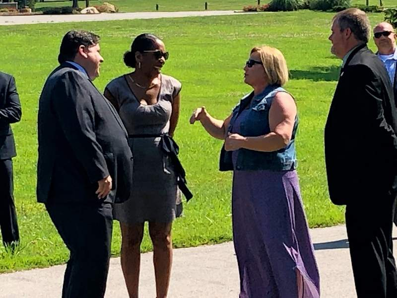 Gov. J.B. Pritzker and Lt. Gov. Juliana Stratton are greeted by Walker's Bluff owner Cynde Bunch and Sesser Mayor Jason Ashmore.