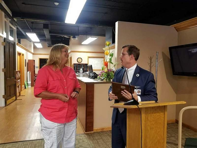Former Police Chief Dawn Tondini, left, is congratulated on Monday by Mayor Mike Absher. Tondini retired in April and was given a plaque in honor of her 26 years of service.