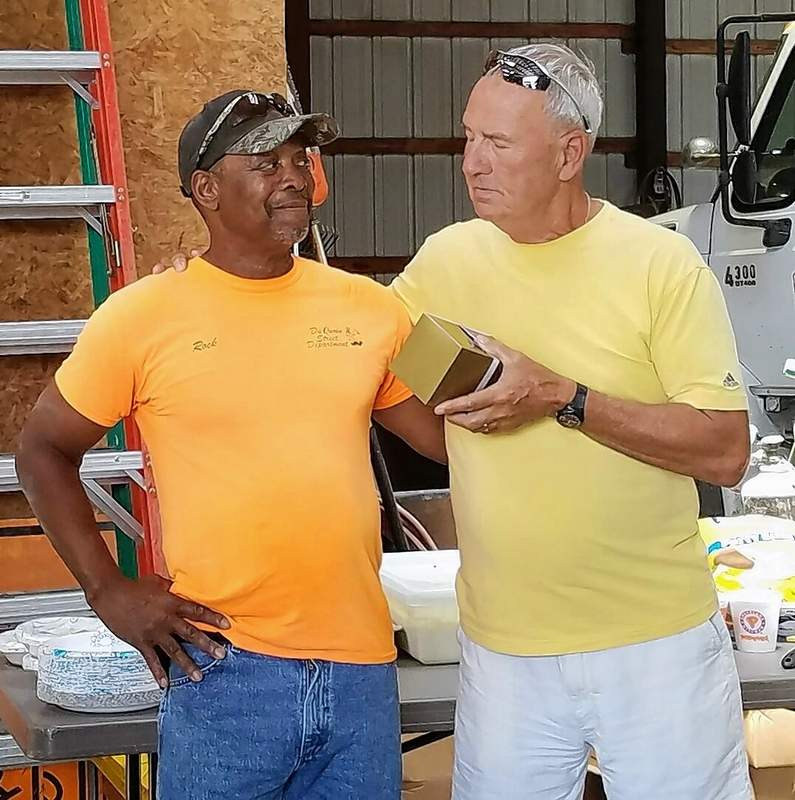 Du Quoin Street Department employee Rocky Anders (left) chats with City Commissioner Bob Karnes last week at a retirement reception for Anders. Karnes presented Anders with a watch.