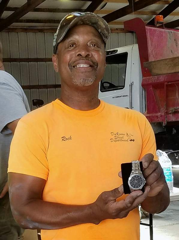 Here, retiring Du Quoin Street Department worker Rocky Anders shows off his retirement gift from the city -- a watch.
