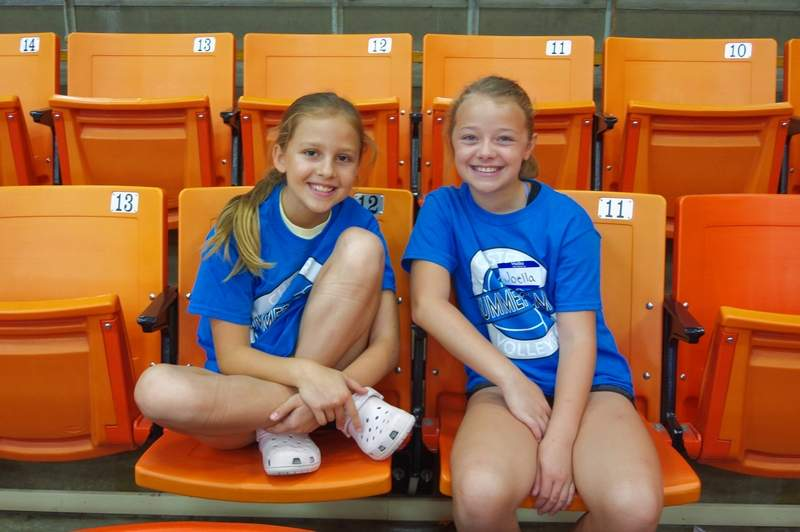 Cousins Aleah, left, and Joella Eggemeyer watch the older group of campers at the 2019 CHS Volleyball Camp July 15-17 at CHS Colbert Gym.They liked camp so much they decided to stay just to watch the older girls in session II.