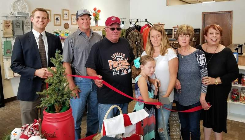 Present at the ribbon cutting are, from left: Chris Koeneman; Ron Woodworth; Chester Mayor Tom Page; owner Stacey Coffey with daughter, Peyton; Linda Sympson and Gwendy Garner.