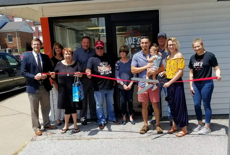 """On July 26, members of the Chester Chamber of Commerce joined the owners at a ribbon cutting for Joe's Pizza & Pasta, 125 E. Stacey St. in Chester, which opened on April 27. From left: Chris Koenemann; Gwendy Garner; Dan Colvis; Chester Mayor Tom Page; Linda Sympson; business owner Angel Osorio, holding his 15-month-old daughter, Amani; Ron Woodworth; Alaina Osorio and General Manager Katelynn Hoch. """"Chester has been awesome,"""" says Angel Osorio. """"We appreciate the support form the community."""""""