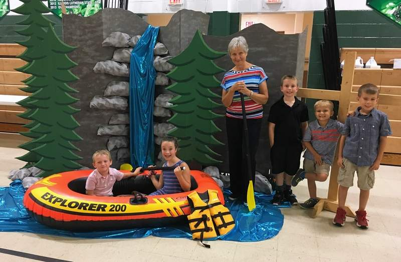 Karen Miller and VBS students pose near the Splash Canyon props built by Miller.