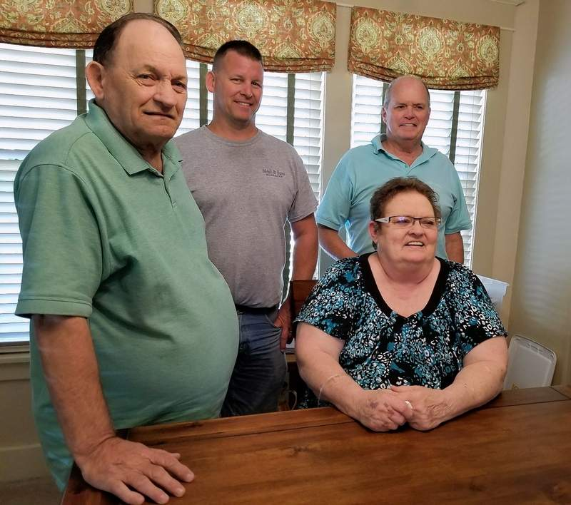 Members of the Rader family meet Jeff Bulmer, upper right. Russ Rader is at left; his son, Rusty Rader is center, and Charlie Rader's sister, Wanda, is seated.