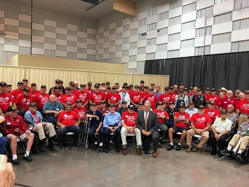 Sen. Dale Fowler joins about 400 veterans gathered at the Marion Pavilion for the first Honor Flight reunion last Saturday.