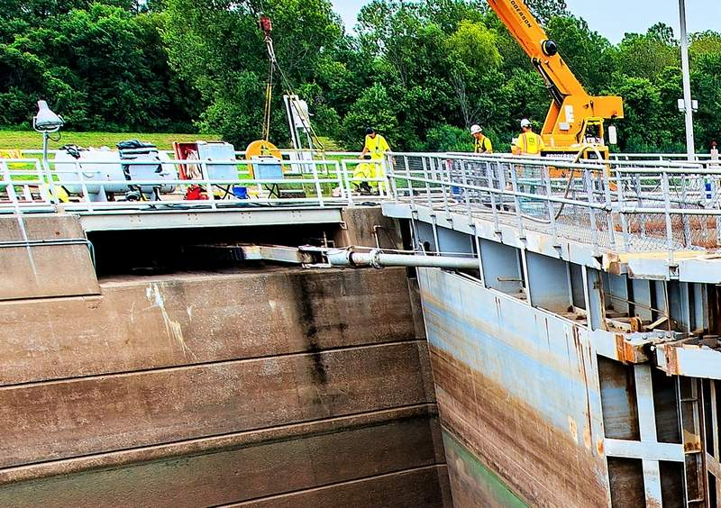 This is the lock arm recess area where debris could get caught if the water is high, and cause the lock to fail. By flushing it out with hoses during the flooding, the lock was able to operate safely at 382.5 feet, two feet higher than normal operating conditions.