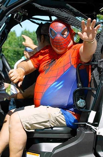Spiderman from Grace Bible Church waves to the crowd.