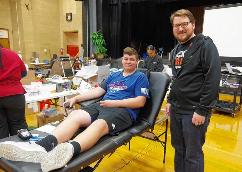 Junior Jaden Mott is a first-time donor, who said he is happy to help someone in need of blood. Adam Guebert, counselor and a student council sponsor, stops to chat after he also donated, via the Power Red Method.